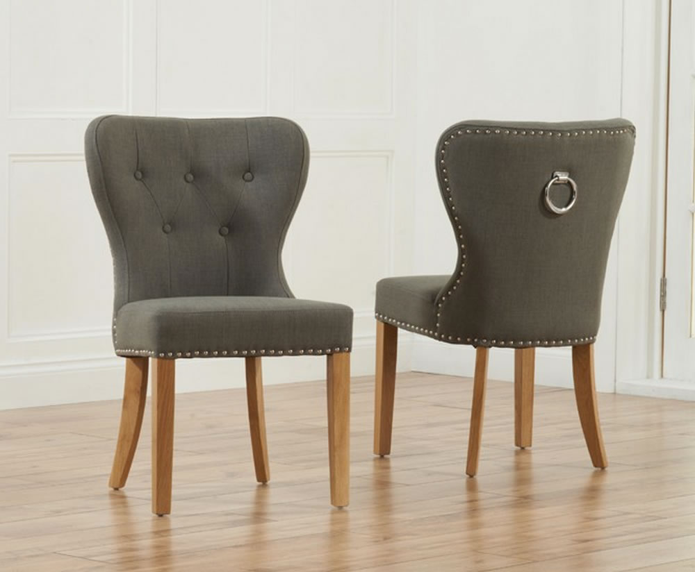 Sudbury grey linen upholstered dining chairs for Upholstered studded dining chairs