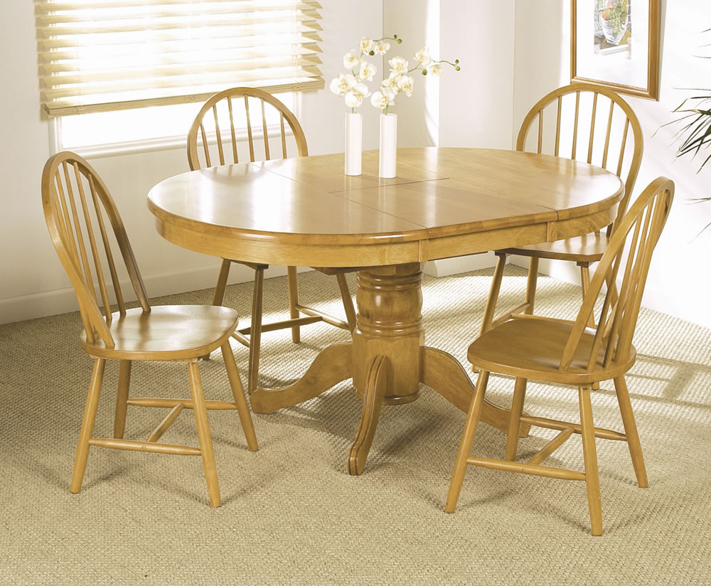 Worcester round extending dining table and 4 chairs for Dining room extendable table