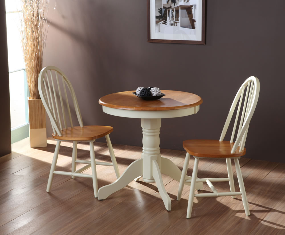 Weald buttermilk traditional round breakfast table and chairs for Small white dining room sets
