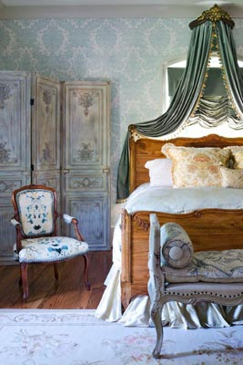 Elegant bedroom furnished with French provincial furniture